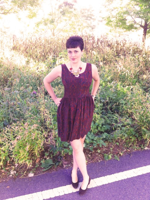 (Here I am wearing it with a Lulu Frost for J. Crew necklace and brown suede pumps on an unseasonably warm, early fall day. But it pairs perfectly with my tumbled black leather jacket, lace print black tights, and ankle boots or a strappy sandal and faux-fur jacket for evening.)