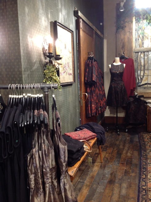 A corner in the Newbury St. store, replete with taffeta and silk holiday dresses